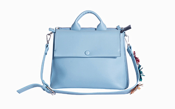 Woman slanting satchel