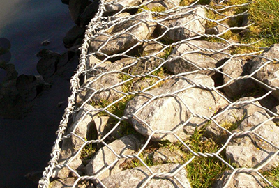 Wire mesh, more planking and stones in lighthouse's future